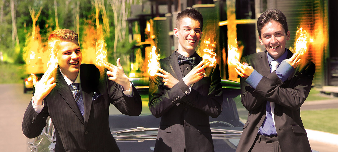 Young Men with Fingers on Fire - Stock Photo