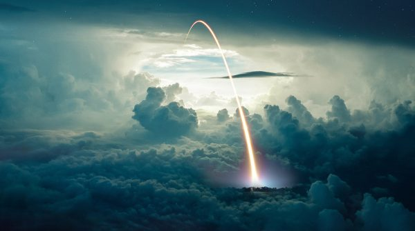 Missile Launch over the Cloudy Sky - Stock Photo