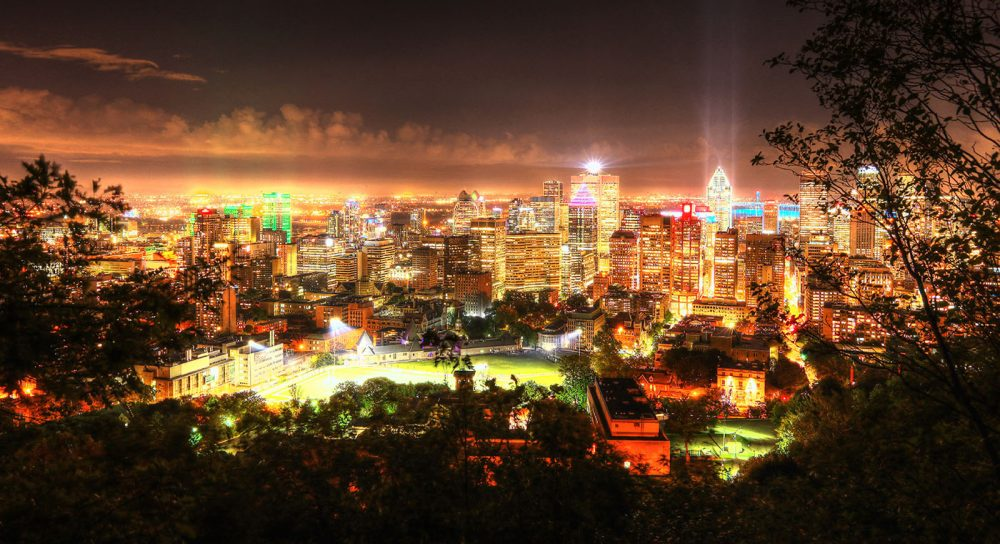 2020 Montreal City Sight at Night from the Mount Royal Hiking Trails - Stock Photo