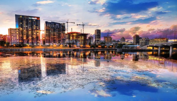 2020 Montreal City at Sunset with Water Reflection - Stock Photo