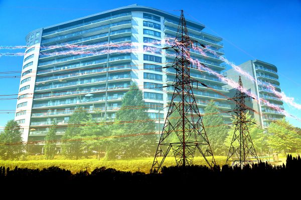 Urban Residential Building Electrification Concept - Stock Photo