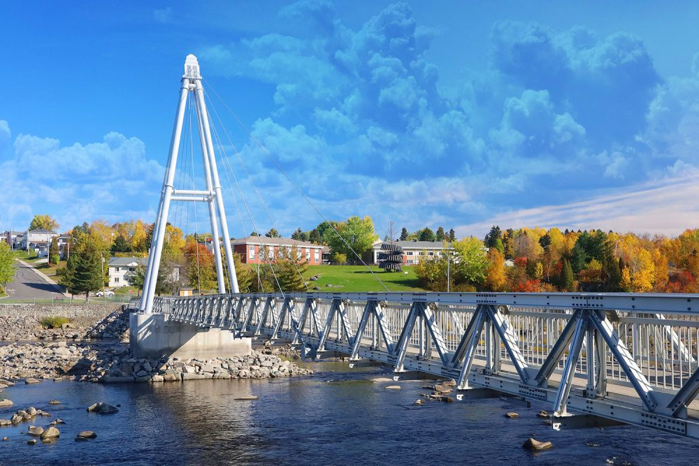Modern Pedestrian River Cross Footbridge in Saguenay